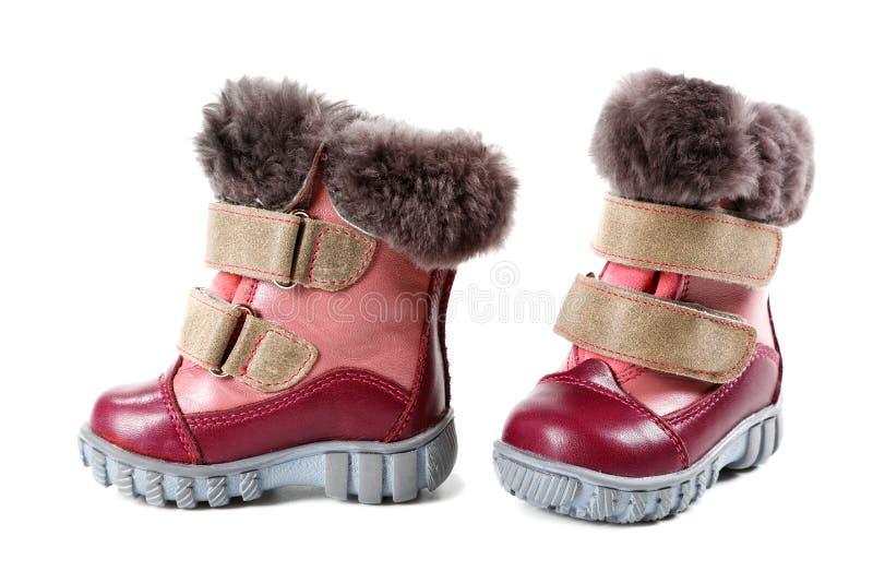 Stivali di inverno dei bambini isolati su bianco fotografie stock libere da diritti
