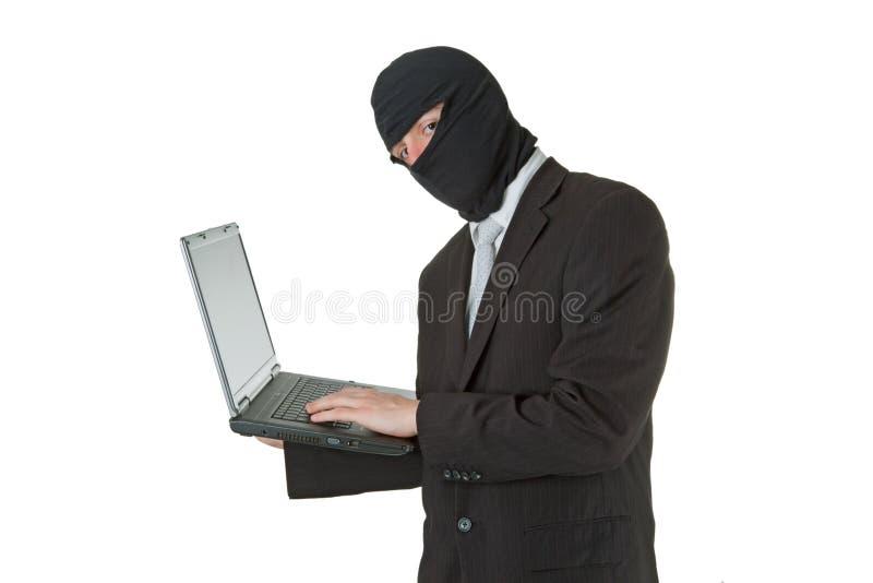 stjäla för databärbar datorman royaltyfria bilder