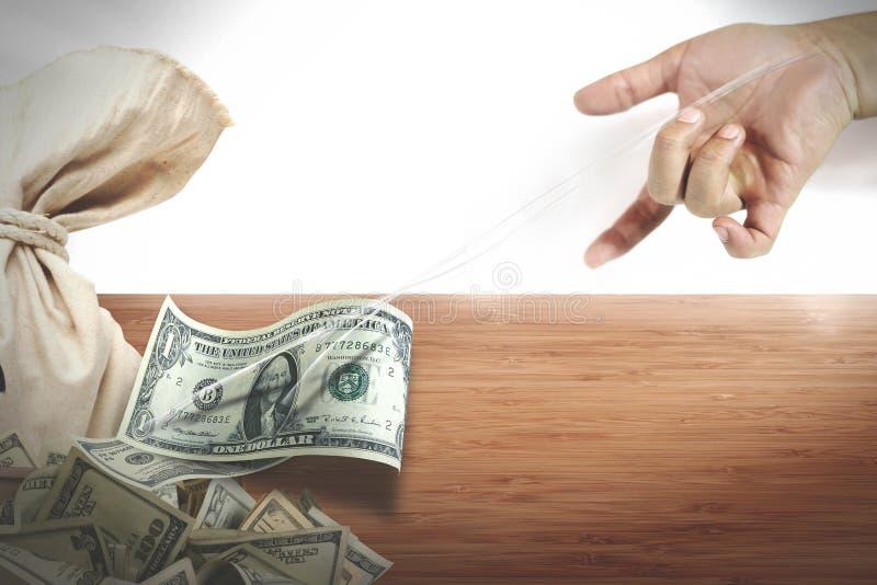 stjäla pengar arkivbild