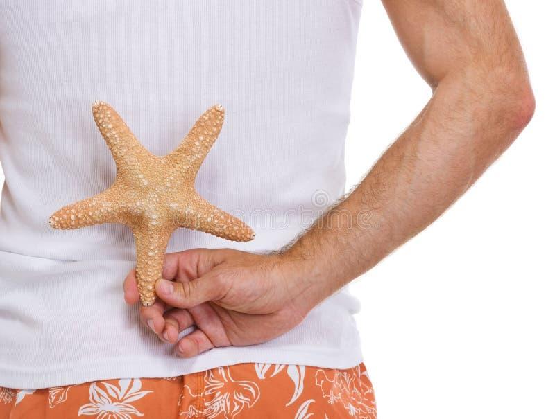 stjärna för hav för manlig för closeuphandholding royaltyfria bilder