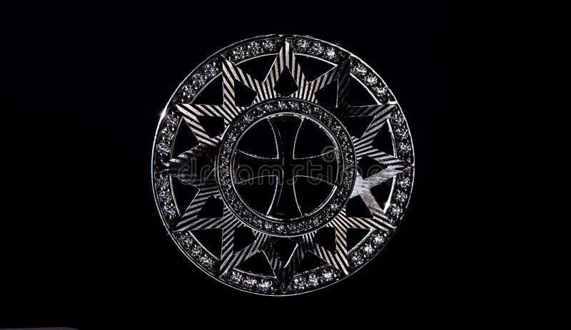 Stjärnan av Ertsgamma Kontur p? en svart bakgrund arkivfoto