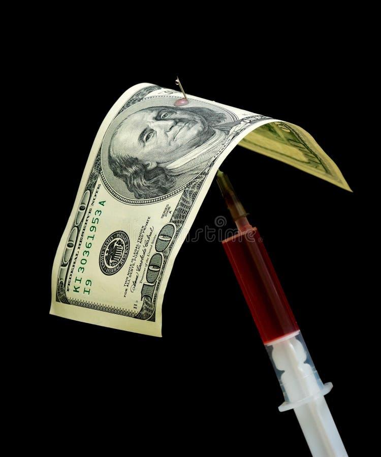 Sto dolary i strzykawek na czarny tle obraz royalty free