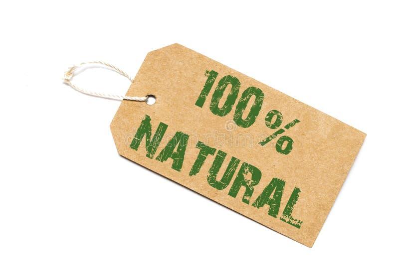 Sto procentów naturalny znak - papierowa metka na bielu obrazy stock