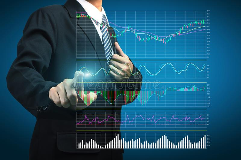 Stock Analysis ideas concept touching the trading graph. Stock Analysis ideas concept businessman pointing or touching the trading graph of stock market on the royalty free stock image