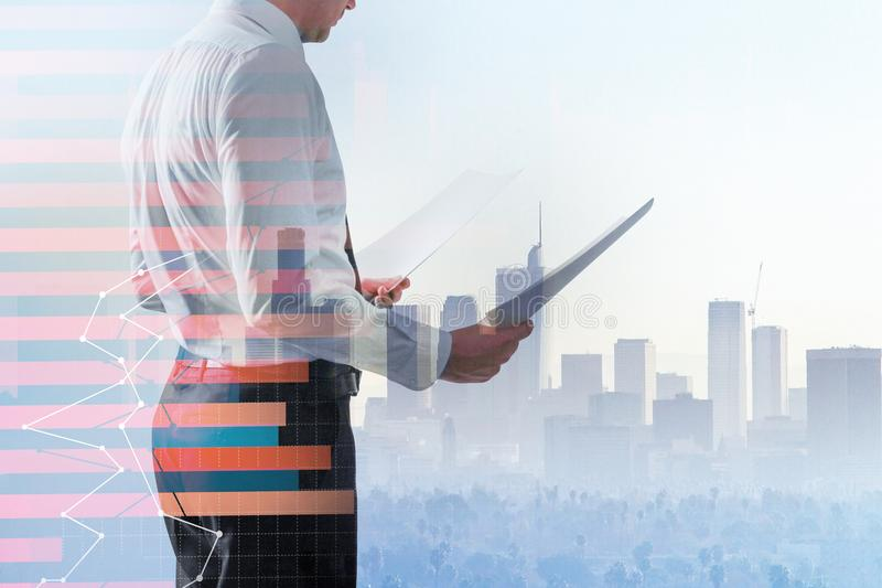 Stock and broker concept. Businessman with document standing on abstract city background with forex chart. Stock and broker concept. Double exposure royalty free stock photography