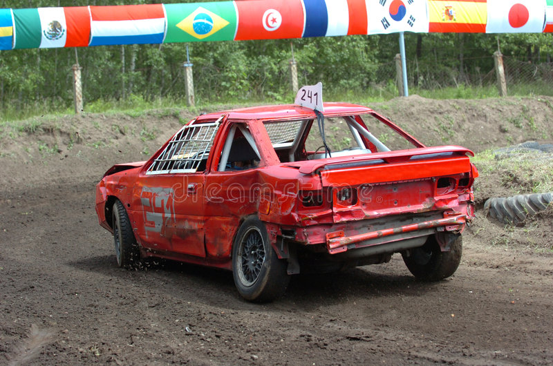 Stock car race. Old red car at stock car race stock photo