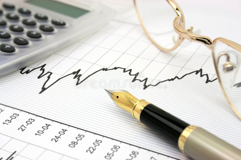 Stock chart. With calculator, fountain pen and eyeglasses royalty free stock image
