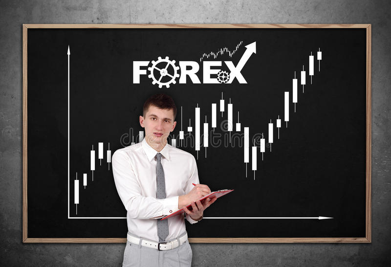 Stock chart. Businessman with clipboard and drawing stock chart on chalk board royalty free stock photos