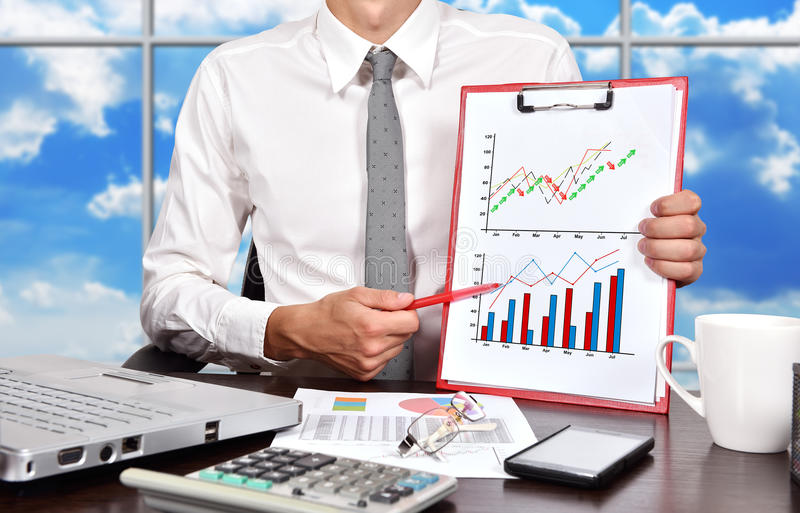 Stock chart. Businessman holaing clipboard with drawing stock chart stock photos