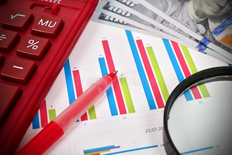 Stock chart. Calculator and pen on workplace royalty free stock photography