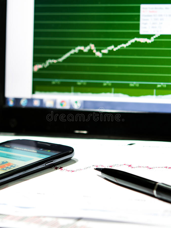 Stock chart data. With black pen and laptop monitor royalty free stock images