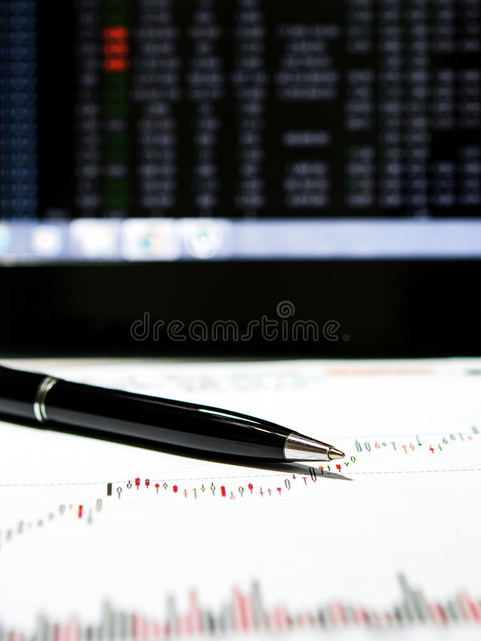 Stock chart data. With black pen and laptop monitor royalty free stock photography