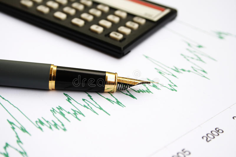 Stock chart and fountain pen. Close-up on fountain pen on a drawn stock chart royalty free stock images