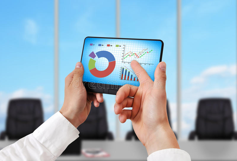 Stock chart. Hand holding digital tablet pc with stock chart royalty free stock image
