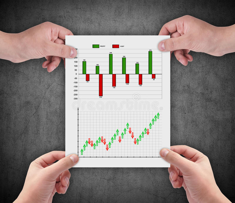 Stock chart. Hands holding paper with drawing stock chart stock photo