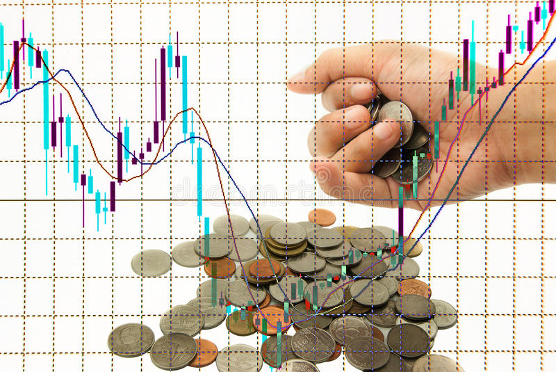 Stock chart in monitor and hand get coins investment concept. Stock chart in monitor, investment concept stock image