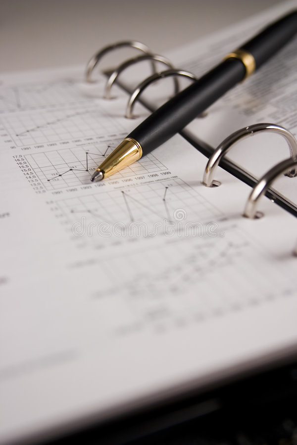Stock chart with a pen. Pointing a graph royalty free stock photo