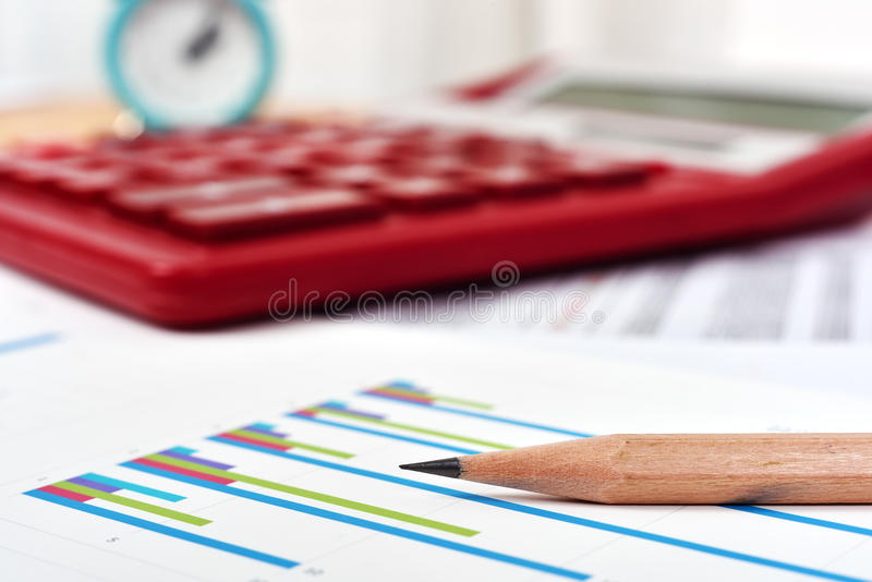Stock chart and pencil. Stock chart, calculator and pencil on workplace stock photos