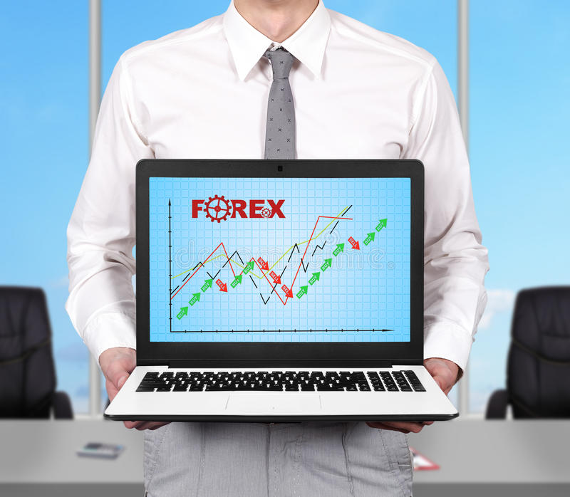 Stock chart. Young businessman holding notebook with stock chart royalty free stock images