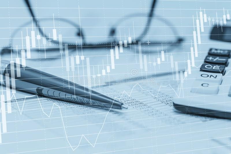 Stock data charts with spreadsheet calculator pen and glasses. Concept abstract photo of stock market financial bank accounting stock images