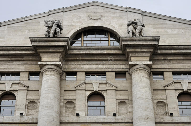 Stock-exchange gable, milan. View of upper part and gable of monumental stock-exchange building in city center stock image