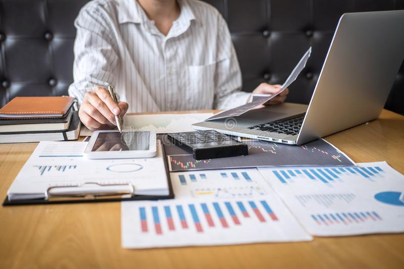 Stock exchange market concept, Business investor trading or stock brokers having a planning and analyzing with display screen and royalty free stock image