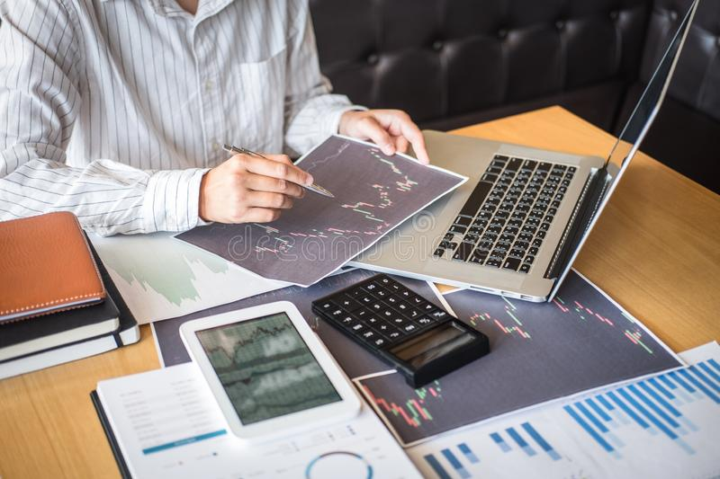 Stock exchange market concept, Business investor trading or stock brokers having a planning and analyzing with display screen and royalty free stock photo