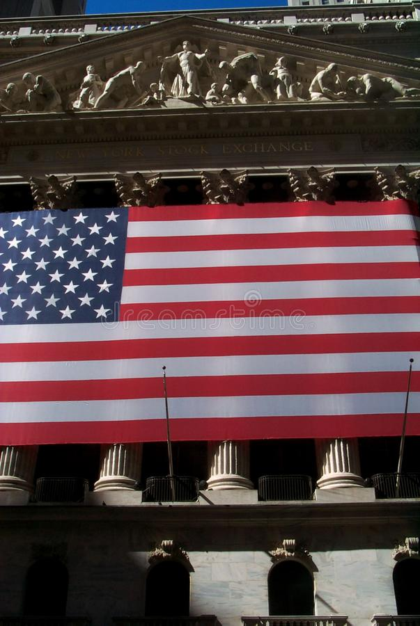 Stock Exchange of New York City, with the United Stated of America flag stars and stripes. royalty free stock image