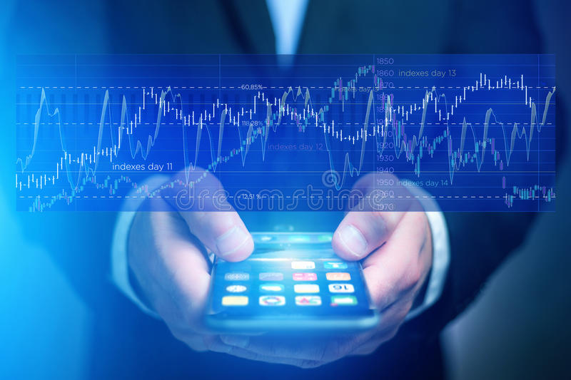 Stock exchange trading data information going out the smartphone. View of Stock exchange trading data information going out the smartphone of a businessman royalty free stock images