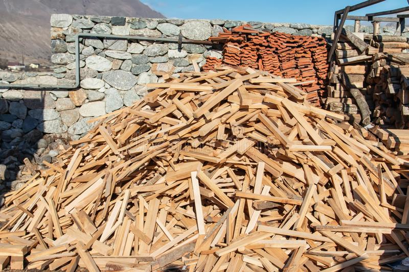 Stock of firewood for winter is in yard in mountain village royalty free stock photo