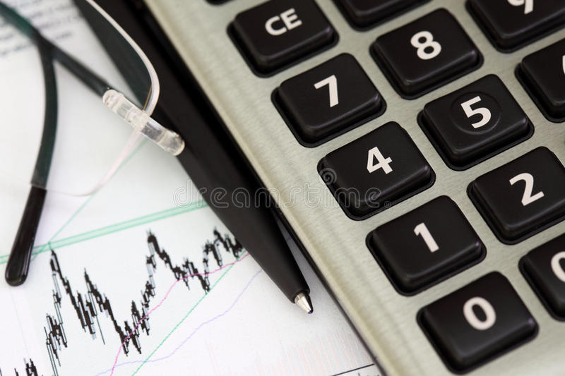 Stock graphic with pen. And calculator royalty free stock photography