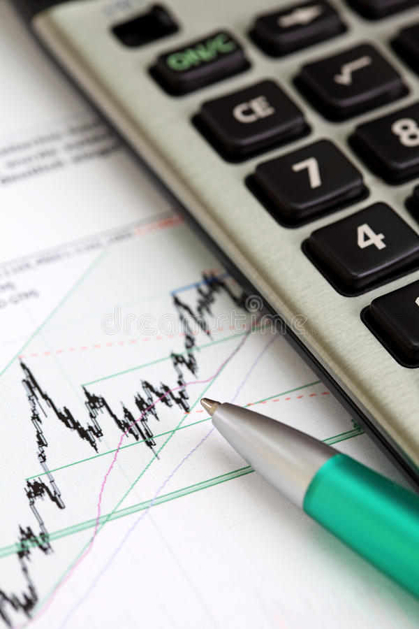 Stock graphic with pen. And calculator royalty free stock photo