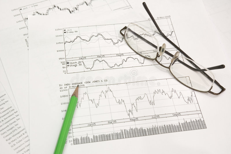Stock graphs, pencil and glasses royalty free stock image
