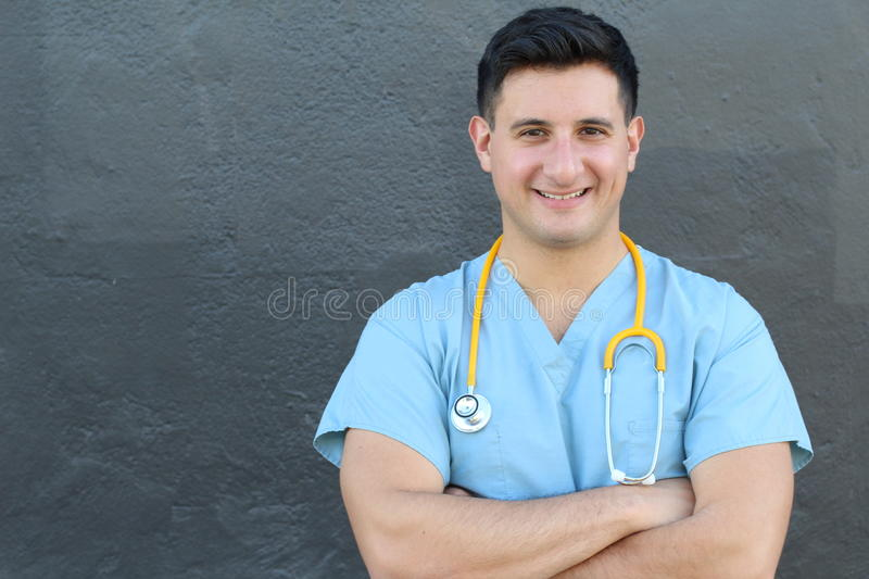 Stock image of medical intern standing with arms crossed over gray background.  stock image