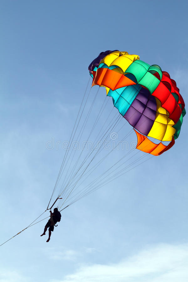 Stock image of parachuting over a sea, towing by a boat stock photo