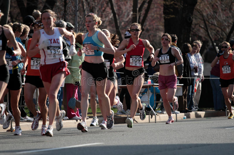Stock image of People running in city marathon royalty free stock photography