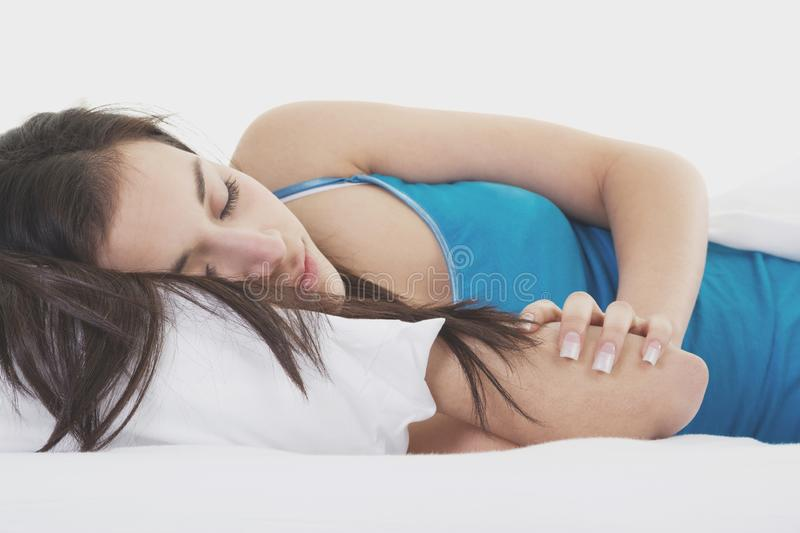 Woman sleeping on white bed stock photos