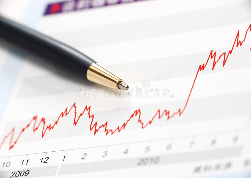 Stock index raise. Concept with pen royalty free stock photography