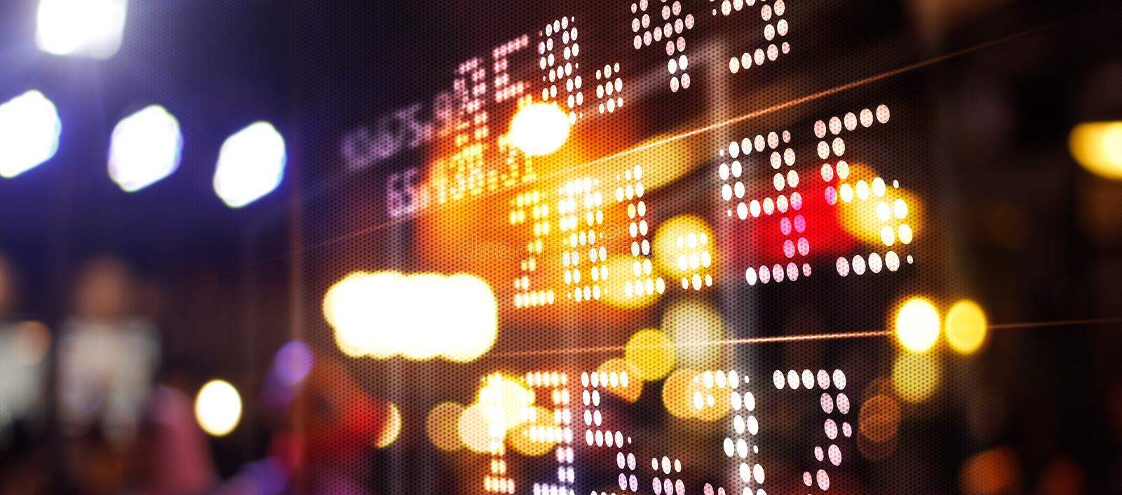 Stock market chart. Abstract graphic. Light of financial stock market numbers on night city and colorful background royalty free stock photos