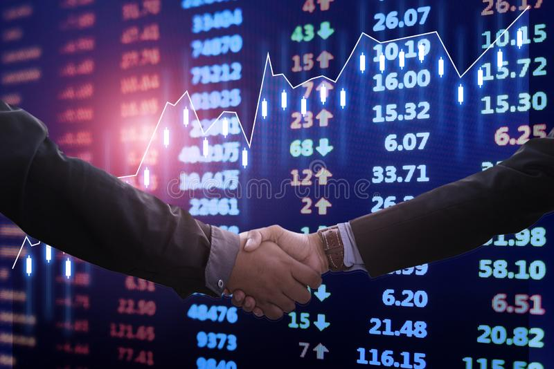 Stock market chart, Financial data on electronic board. With Business Collaboration, Businessman shake hands stock images