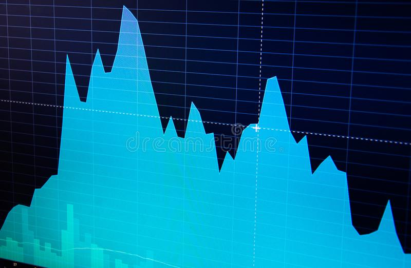 Stock market chart, graph on blue background. Stock market graph on the screen. Stock exchange graph royalty free stock images