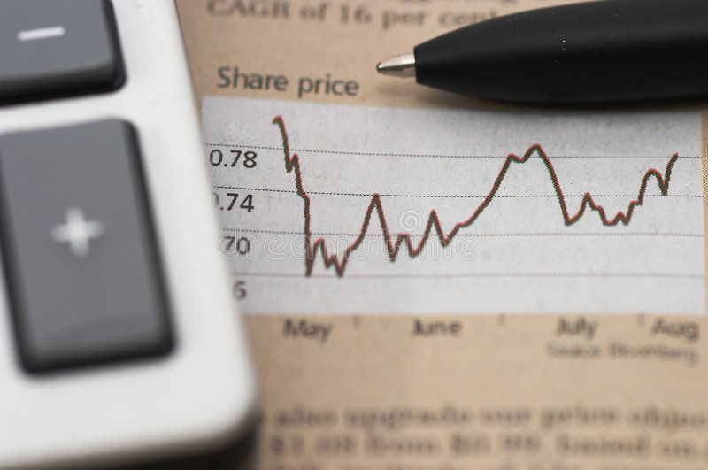 Stock market chart, with pen, closeup. Stock chart analysis, calculator, with pen, horizontal orientation. charts, analysis, ups and downs, closeup, shallow stock image