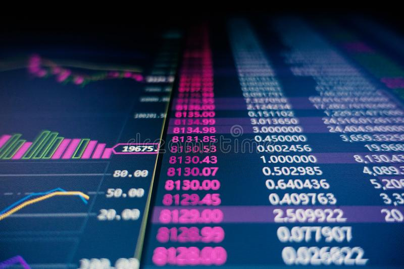 Stock Market fluctuation. Stock and bitcoin market fluctuation on a screen. Encryption currency prices. - Image royalty free stock photos
