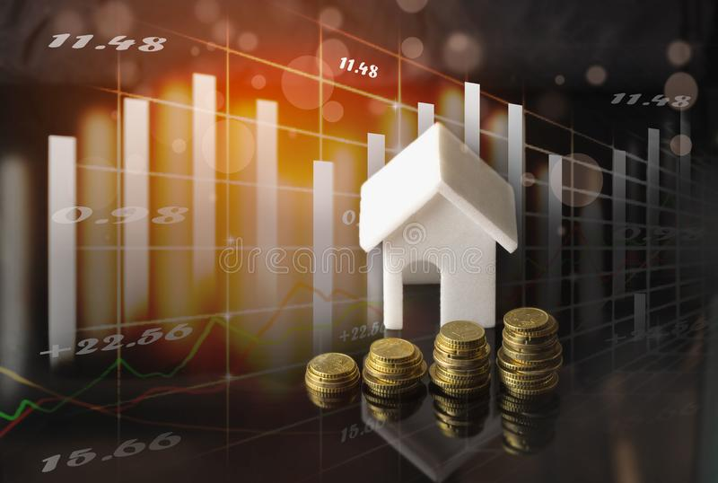 Stock market or forex trading graph and candlestick chart suitable for Real estate investment. Economy trends background for business idea and all art work stock photo