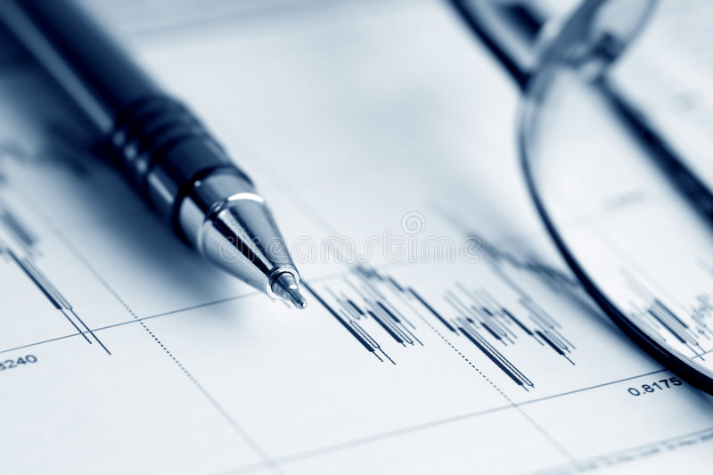 Stock market graphs analysis. Analysis of the financial information on stock market reports royalty free stock photo