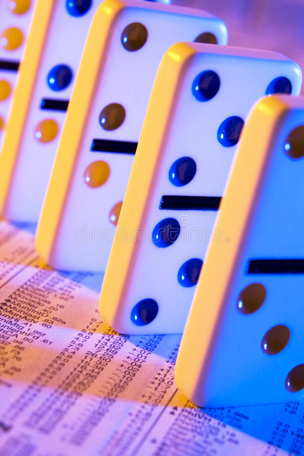 Stock market is no game. Dominos on stock report royalty free stock images