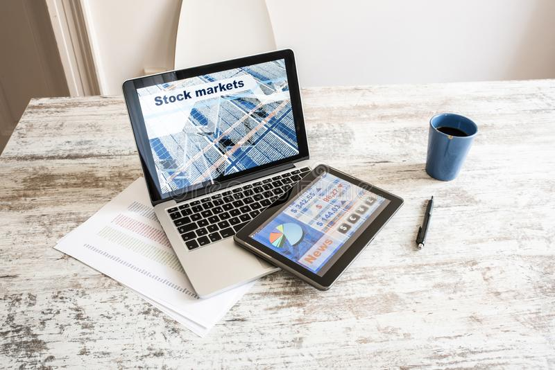 Stock market trading app on a Tablet PC and Laptop PC. Stock market trading and research software on a Tablet PC with a Laptop computer stock photos