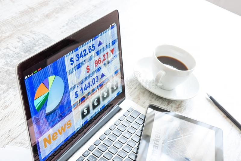 Stock market trading app on a Tablet PC and Laptop PC. Stock market trading and research software on a Tablet PC with a Laptop computer royalty free stock image