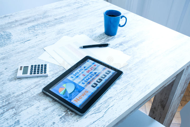 Stock market trading app on a Tablet PC. Stock market trading and research software on a Tablet PC on a office Desktop royalty free stock photo