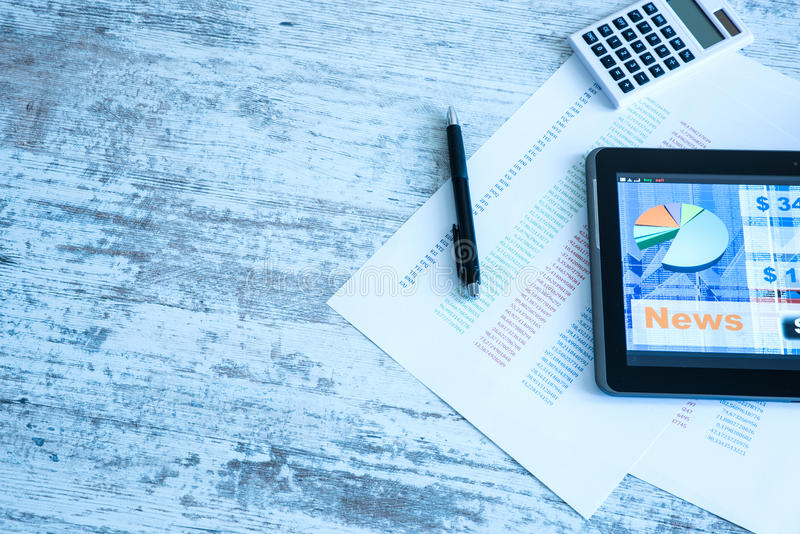 Stock market trading app on a Tablet PC. Stock market trading and research software on a Tablet PC on a office Desktop stock photos